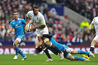 Courtney Lawes is tackled in possession. RBS Six Nations match between England and Italy on March 10, 2013 at Twickenham Stadium in London, England. Photo by: Patrick Khachfe / Onside Images