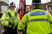 Saturday 05 April 2014<br /> Pictured: Police talk to white pride supporters <br /> Re: White Pride and Anti Fascist groups protest in Swansea City Cebtre