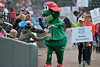Mascot Reedy Rip'It of the Greenville Drive parades around the field with school children before a game against the Asheville Tourists on Sunday, April 10, 2016, at Fluor Field at the West End in Greenville, South Carolina. (Tom Priddy/Four Seam Images)
