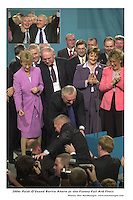 Taoiseach bertie Ahern pulls Paidi O'Seonto the stage at  the Fianna fail Ard Fheis in the Gleneagle Hotel, Killarney on Saturday..Picture by Don MacMonagle