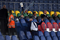 A man waves a scarf on the tribune during the Serie A football match between SS Lazio and Cagliari Calcio at Olimpico stadium in Rome ( Italy ), July 23th, 2020. Play resumes behind closed doors following the outbreak of the coronavirus disease. Photo Andrea Staccioli / Insidefoto