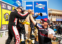 Jul 28, 2019; Sonoma, CA, USA; NHRA top fuel driver Billy Torrence (left) celebrates with son Steve Torrence after winning the Sonoma Nationals at Sonoma Raceway. Mandatory Credit: Mark J. Rebilas-USA TODAY Sports