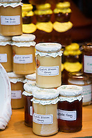 Jars of English blossom honey and lavender honey for sale alongside jams and preserves at Burford in the Cotswolds, UK