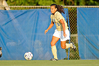 27 August 2011:  FIU's Ashleigh Shim (9) moves the ball upfield in the first half as the FIU Golden Panthers defeated the University of Arkon Zips, 1-0, at University Park Stadium in Miami, Florida.