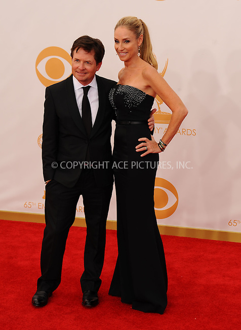 WWW.ACEPIXS.COM<br /> <br /> September 22 2013, LA<br /> <br /> Michael J Fox arriving at the 65th Annual Primetime Emmy Awards at Nokia Theatre L.A. Live on September 22, 2013 in Los Angeles, California.<br /> <br /> By Line: Peter West/ACE Pictures<br /> <br /> <br /> ACE Pictures, Inc.<br /> tel: 646 769 0430<br /> Email: info@acepixs.com<br /> www.acepixs.com