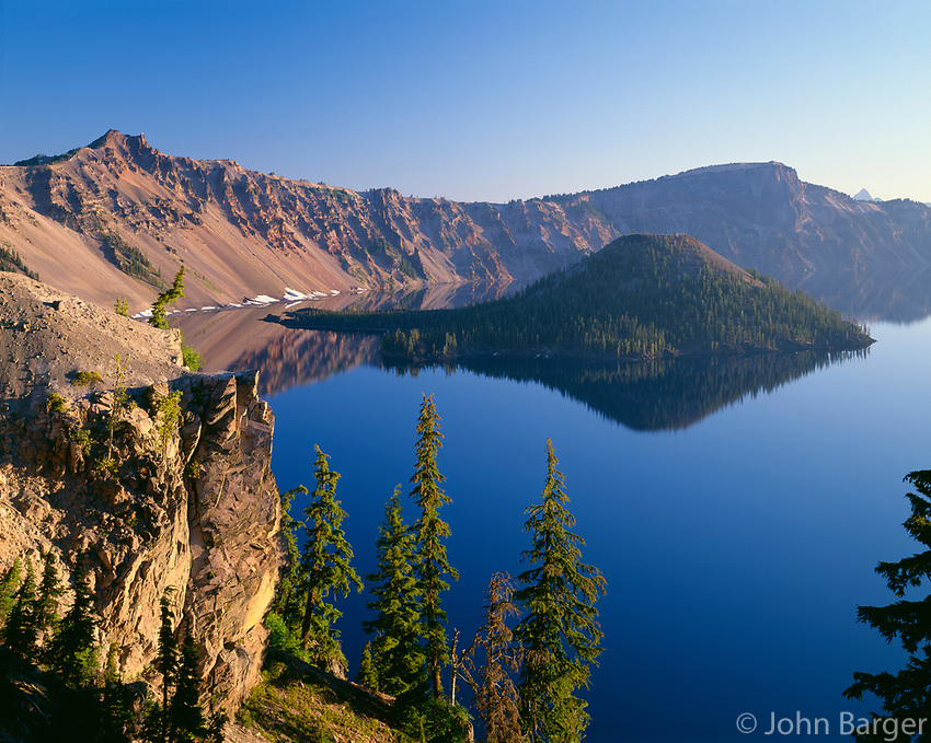 ORCL_045 - USA, Oregon, Crater Lake National Park, West rim of Crater Lake with Hillman Peak (left) and Llao Rock (right) overlooking Wizard Island in early morning.