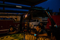 Journalist Jesus Olivares converses with colleagues at a Fire Station, where he volunteers part time, when he is not reporting, on June 29, 2016 in Veracruz, Mexico. <br /> Photo Daniel Berehulak for the New York Times