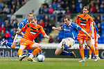 St Johnstone v Dundee Utd....21.04.12   SPL.Scott Robertson scores to make it 1-0 despite the efforts of Frazer Wright.Picture by Graeme Hart..Copyright Perthshire Picture Agency.Tel: 01738 623350  Mobile: 07990 594431