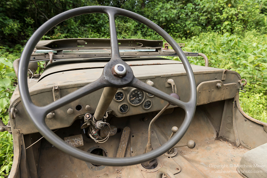Munda, Western Province, Solomon Islands; the steering wheel and dashboard of a 1942 Jeep Willy parked on one of the original jungle roads used by US troops during World War II, it is the only known restored and functioning Jeep from that era in the Solomon Islands