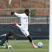 University of Connecticut forward Stephane Diop (5) shoots wide of open net after beating the goalkeeper..NCAA Tournament. With a goal in the second overtime, University of Connecticut (white) defeated University of New Mexico (red), 2-1, at Morrone Stadium at University of Connecticut on November 25, 2012.