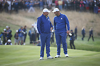 Jon Rahm (Team Europe) with Thomas Bjorn (Team Europe Captain) during Sunday's Singles, at the Ryder Cup, Le Golf National, Île-de-France, France. 30/09/2018.<br /> Picture David Lloyd / Golffile.ie<br /> <br /> All photo usage must carry mandatory copyright credit (© Golffile | David Lloyd)