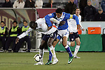 19 November 2008: Jozy Altidore (Villarreal)(14) of the USA shields the ball from Christian Noriega (Municipal)(3) of Guatemala.  The United States Men's National Team defeated the visiting Guatemala Men's National Team 2-0 at Dick's Sporting Goods Park in Commerce City, Colorado in a CONCACAF semifinal round FIFA 2010 South Africa World Cup Qualifier.