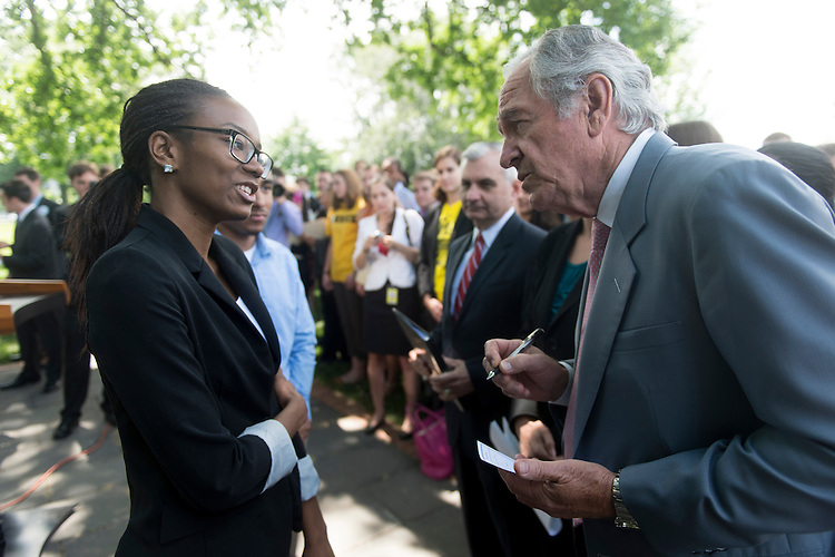 UNITED STATES - JUNE 6: Sen. Jack Reed, D-R.I., center, and Sen. Tom Harkin, D-Iowa, right, speak with Tiffany Loftin, vice president of the U.S. Students Association, as they arrive for a rally with college students from across the country to urge against an interest rate increase in the federally subsidized Stafford loans on Wednesday, June 6, 2012. (Photo By Bill Clark/CQ Roll Call)
