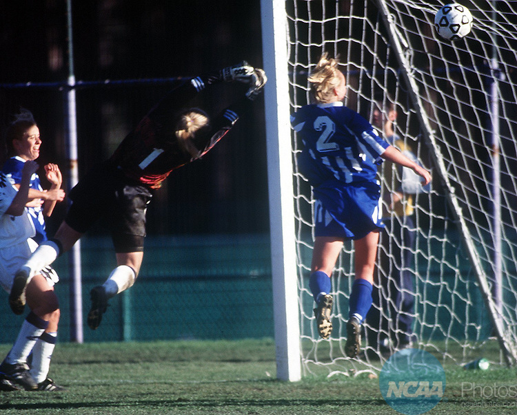 17 Nov. 1996:  San Diego defender Beth Freeburg (2) gets past New Jersey goalie Daniela Kolarsick (1) and scores for her team  during the Division 3 Women's Soccer Championship at Amherst College's Hitchcock Field. UC San Diego defeated The College of New Jersey 2-1 for the championship title. Ben Barnhart/NCAA Photos