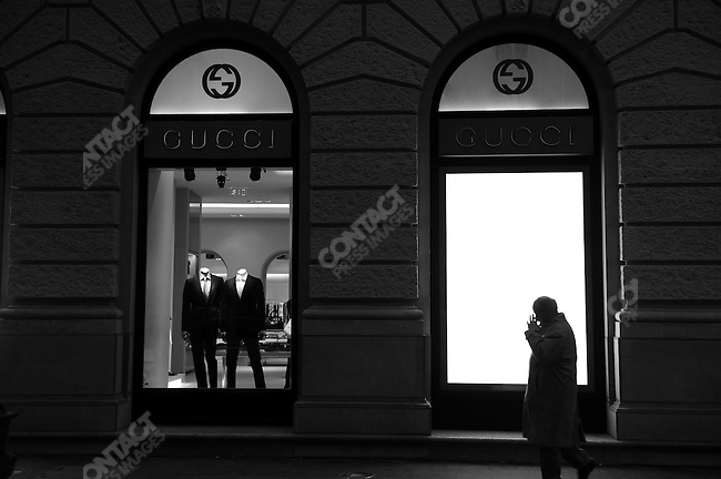 A man walked past the window of a Gucci store off Andrassy Road in Budapest, Hungary, March 23, 2008