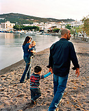 GREECE, Patmos, Skala, Dodecanese Island, taverna owner Yannis Kaneli with his family on the beach in front of his restaurant, Taverna Tzivaeri