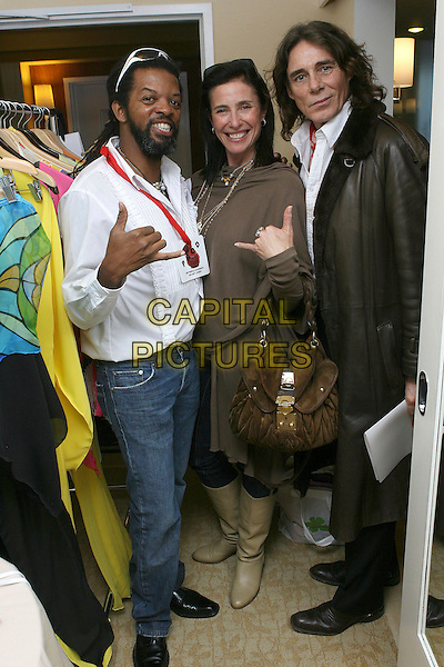 "ARID CHAPPELL, MIMI ROGERS & GEORGE BLODWELL.2007 Golden Globe ""All Around The World"" Style Lounge - Day One held before the 64th Annual Golden Globe Awards at the Beverly Hilton, Beverly Hills, California, USA,.12 January 2007..full length.CAP/ADM/ZL.©Zach Lipp/AdMedia/Capital Pictures."