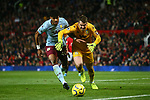 Tyrone Mings battles Tom Heaton of Aston Villa during the Premier League match at Old Trafford, Manchester. Picture date: 1st December 2019. Picture credit should read: Phil Oldham/Sportimage