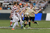 Houston, TX - Friday December 11, 2016: Brad Dunwell, (12) of the Wake Forest Demon Deacons clears the ball from the midfield against the Stanford Cardinal at the NCAA Men's Soccer Finals at BBVA Compass Stadium in Houston Texas.