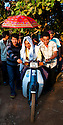 SREY BREY VILLAGE, CAMBODIA-- The groom Noung Chomrong, 26, is escorted to his bride atop a moto in Srey Brey Village, Kampong Chhnang province. Rituals of the Imam San Cham, traditional Cambodian Muslims, are carried out over three days. PHOTO BY JODI HILTON