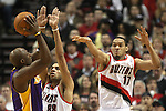 04/08/11--Trailblazers' Nicolas Batum and Chris Johnson closely defend Lakers' Lamar Odom in Portland's 93-86 win over L.A. at the Rose Garden..Photo by Jaime Valdez........................................