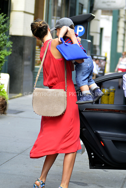 WWW.ACEPIXS.COM . . . . .  ....July 18 2012, New York City....Model Miranda Kerr carries her son Flynn Bloom to a car outside her Chelsea apartment on July 18 2012 in New York City....Please byline: CURTIS MEANS - ACE PICTURES.... *** ***..Ace Pictures, Inc:  ..Philip Vaughan (212) 243-8787 or (646) 769 0430..e-mail: info@acepixs.com..web: http://www.acepixs.com