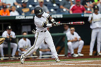 Vanderbilt Commodores designated hitter Ro Coleman (1) swings the bat during the NCAA College baseball World Series against the Cal State Fullerton Titans on June 15, 2015 at TD Ameritrade Park in Omaha, Nebraska. Vanderbilt beat Cal State Fullerton 4-3. (Andrew Woolley/Four Seam Images)