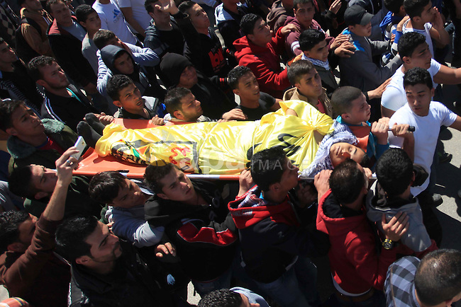 Palestinians carry tthe bodies of the three Palestinians during their funeral in the West Bank refugee camp of Jenin on Saturday, March 22, 2014. Israeli troops killed at least three Palestinians in an early morning raid that was followed by a clash with angry protesters in a West Bank town on Saturday, the military and Palestinian security officials said, in the deadliest incident in months. Photo by Issam Rimawi