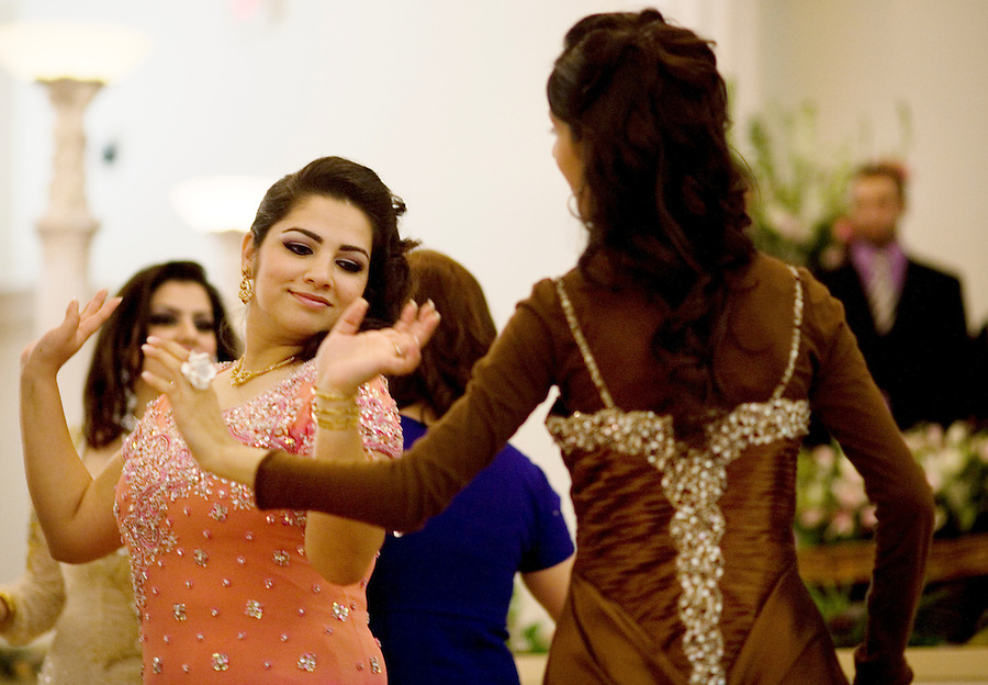 Afghan-Americans dance to traditional music at an engagement party, at the Diamond Palace, in Fremont, Ca., on Saturday, March 7, 2009.