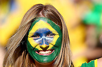 A Brazil fan with painted face soaks up the atmosphere inside the Itaquerao stadium ahead of kick off in the opening match of the 2014 World Cup vs Croatia