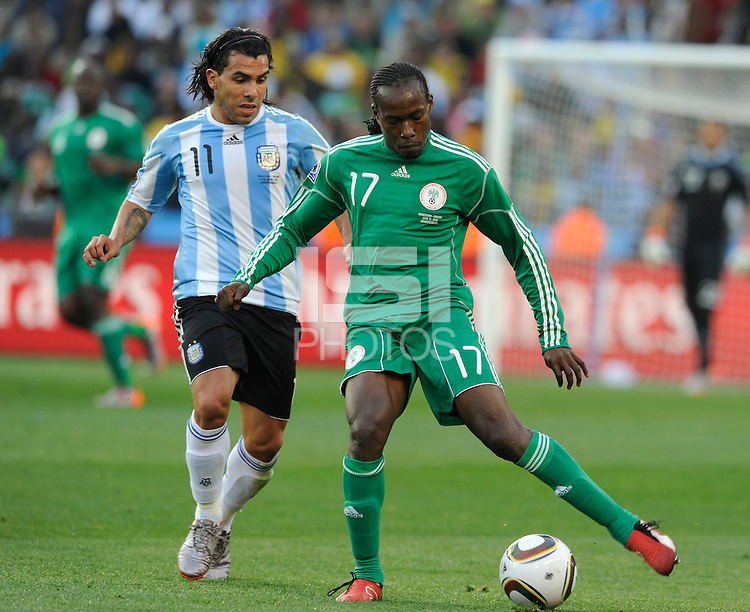 Carlos Tevez of Argentina and Chidi Odiah of Nigeria