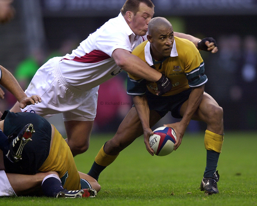 Photo. Richard Lane.England v Australia at Twickenham. 16-11-2002.Investec Challenge Cook Cup..George Gregan fails to clear the ball as Steve Thompson tackles.