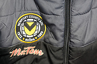 Pictured: The Newport County emblem on the jacket of Michael Flynn. Thursday 18 January 2018<br /> Re: Players and staff of Newport County Football Club prepare at Newport Stadium, for their FA Cup game against Tottenham Hotspur in Wales, UK