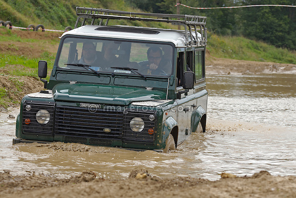Land Rover crossing through a flooded dirt track in Bining, France. --- No releases available. Automotive trademarks are the property of the trademark holder, authorization may be needed for some uses.