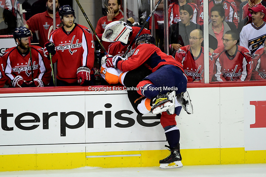 Friday, April 22, 2016: Philadelphia Flyers center Brayden Schenn (10) is checked into the Capitals bench by Washington Capitals left wing Alex Ovechkin (8) during game 5 of the first round of the National Hockey League Eastern Conference playoffs  between the Philadelphia Flyers and the Washington Capitals held at the Verizon Center in Washington, DC. Eric Canha/CSM