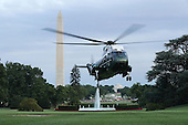 With United States President Barack Obama and first lady Michelle Obama on board, Marine One lands on the South Lawn of the White House with July 12, 2016 in Washington, DC. The Obamas were returning from Dallas where they attended a public memorial service for the five Dallas police officers who were killed by a sniper last week during a Black Lives Matter demonstration.<br /> Credit: Chip Somodevilla / Pool via CNP