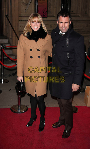 "GABBY LOGAN & KENNY LOGAN .VIP Gala Premiere of Cirque de Soleil's ""Quidam"" at the Royal Albert Hall, London, England,  January 6th 2009.Cirque de Soleil full length brown camel tan coat married couple husband wife black fur scarf .CAP/ROS.©Steve Ross/Capital Pictures"
