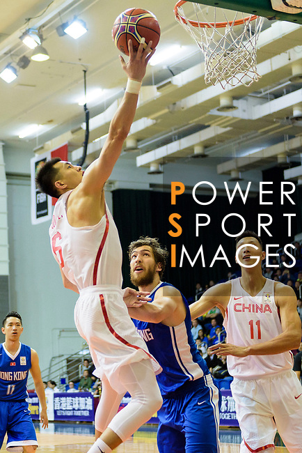 Ailun Guo of China (L) in action against Duncan Reid of Hong Kong (R) during the FIBA Basketball World Cup 2019 Asian Qualifier Group A match between Hong Kong and China at Southorn Stadium on February 26, 2018 in Hong Kong. Photo by Marcio Rodrigo Machado / Power Sport Images