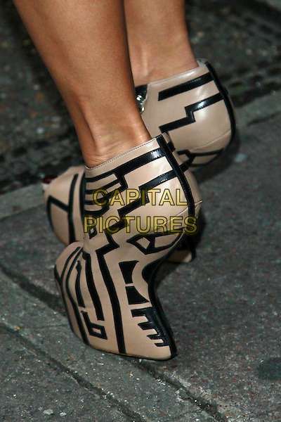 Nicole Scherzinger's shoes .Poses and signs autographs outside BBC Radio 1 Studios, London, England, UK, October 28th 2011..detail feet  peep toe heel-less shoes wedges platforms beige black platform  print peep toe .CAP/HIL.©John Hillcoat/Capital Pictures.