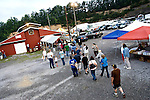 WISE, VIRGINIA-JULY 25: People line up to register in a farm building at the Virginia-Kentucky Fairgrounds for free medical services at a makeshift medical camp provided by the Remote Area Medical (RAM)  July 25, 2009. RAM, operating in 5 states this year as well as overseas, provides free medical, dental and vision care to people in need. The vast majority of people receiving care at the two and half day event have no health insurance for their families or are underinsured.