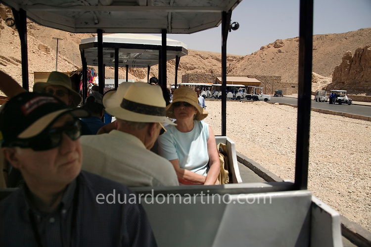 Tourists access the Valley of the Kings using a shuttle service. It's believed the government intends to create something similar at the Valley of the Nobles, as soon as the Qurna village is cleared from its inhabitants and their houses. The current informal experience through which tourists walk around and interact with villagers is expected to be substituted by a more formal, commercial, impersonal approach. .Luxor, Egypt..Photo: Eduardo Martino