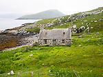 Deserted derelict croft cottage in coastal location at Port Deas an Uidhe, Vatersay Island, Barra, Outer Hebrides, Scotland, UK