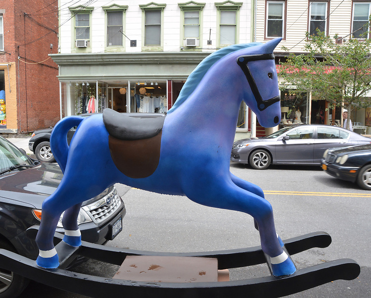 "A view of, ""Blue Horse"" by artist, Bill Reinhart, one of the 35 Artist painted Rocking Horses on display around Saugerties, NY as part of the Chamber of Commerce sponsored Art in the Village Project titled ""Rockin' Around Saugerties."" This photo taken on Friday, May 26, 2017. Photo by Jim Peppler. Copyright/Jim Peppler-2017."