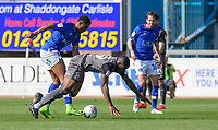 Lincoln City's John Akinde vies for possession with Carlisle United's Kelvin Etuhu<br /> <br /> Photographer Chris Vaughan/CameraSport<br /> <br /> The EFL Sky Bet League Two - Carlisle United v Lincoln City - Friday 19th April 2019 - Brunton Park - Carlisle<br /> <br /> World Copyright © 2019 CameraSport. All rights reserved. 43 Linden Ave. Countesthorpe. Leicester. England. LE8 5PG - Tel: +44 (0) 116 277 4147 - admin@camerasport.com - www.camerasport.com