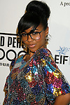 LOS ANGELES, CA. - February 05: Recording Artist Simone arrives at the Black Eyed Peas Peapod Foundation benefit concert presented by Adobe Youth Voices inside the Conga Room at the Nokia Theatre L.A. Live on February 5, 2009 in Los Angeles, California.