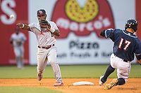 Louisville Bats second baseman Dilson Herrera (15) turns a double play as Toledo Mud Hens baserunner Efren Navarro (17) slides into second during the International League baseball game on May 17, 2017 at Fifth Third Field in Toledo, Ohio. Toledo defeated Louisville 16-2. (Andrew Woolley/Four Seam Images)