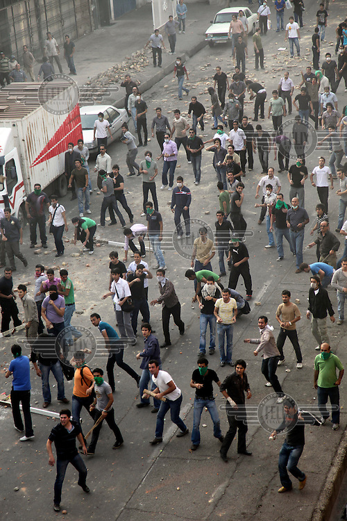 Demonstrators on Khosh Street throw missiles. Following a disputed election result, thousands of supporters of opposition candidate Mir-Hossein Mousavi took to the streets in protest.