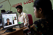 A resident sits in front of the camera and has her photo taken in Mysore city in Karnataka. For national security reasons and to improve monitoring of citizens, India is issuing each one of its 1.2 billion people with a unique ID card and number based on a photograph, digital finger print and iris scan.Photograph: Sanjit Das/Panos