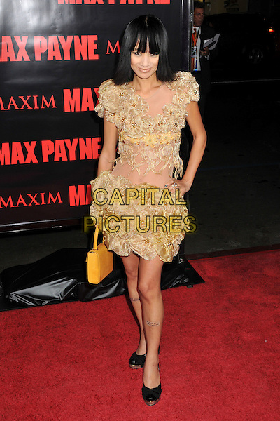 "BAI LING .""Max Payne"" Los Angeles Premiere at Grauman's Chinese Theatre, Hollywood, California, USA..October 13th, 2008.full length yellow gold gathered ruffle ruffles dress sheer hand on hip bag purse.CAP/ADM/BP.©Byron Purvis/AdMedia/Capital Pictures."