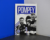 Ben Close (l), Jamal Lowe  and Tom Naylor of Portsmouth on the front of the match day programme during Portsmouth vs Gillingham, Sky Bet EFL League 1 Football at Fratton Park on 6th October 2018